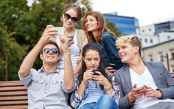 Students or teenagers with smartphones at campus Royalty Free Stock Photos