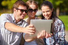 Students or teenagers with tablet pc taking selfie Stock Images