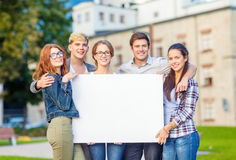 Students or teenagers with white blank board Royalty Free Stock Image