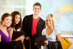 Students: Teens In Class With Graduation Caps and Gowns stock photography