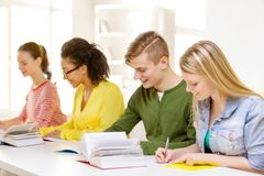 Students with textbooks and books at school Royalty Free Stock Images