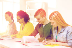 Students with textbooks and books at school Royalty Free Stock Image