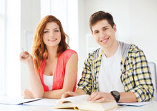 Students with textbooks and books at school Royalty Free Stock Photo