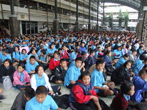 Students, Thailand. BANGKOK, THAILAND - DECEMBER 20 : Students sit outside for morning assembly at Seekan school December 20, 2005 in Bangkok Stock Photo