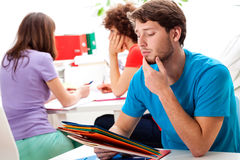 Students thinking about difficult exercise Stock Image