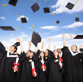 students throwing graduation caps into the Air stock image