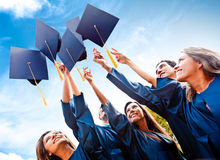 Students throwing graduation hats Stock Photography