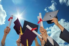 Free Students Throwing Graduation Hats Royalty Free Stock Photo - 57274685