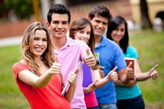 Students with thumbs up Royalty Free Stock Images