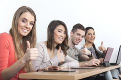 Students thumbs up Royalty Free Stock Photos