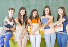 Students with thumbs up. Group of students in the classroom with thumbs up Stock Images