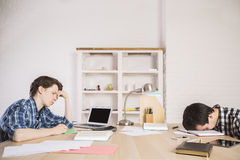 Students tired of studying Stock Photos