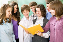 Students to read textbook. Group of students to read textbook in the classroom Stock Photo