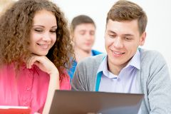 Students together to discuss lecture Royalty Free Stock Photos
