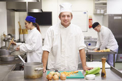 Students Training To Work In Catering Industry Stock Images