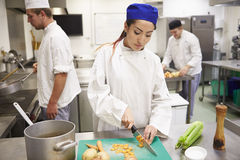 Students Training To Work In Catering Industry Stock Photos