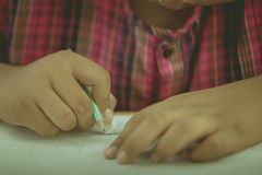 Students try to drawing a basic pattern Thailand with a pencil i. N classroom stock photography