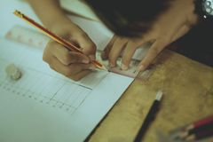 Students try to drawing a basic pattern Thailand with a pencil i. N classroom royalty free stock image