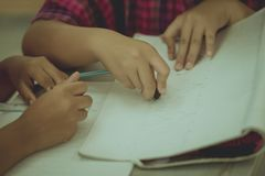 Students try to drawing a basic pattern Thailand with a pencil i. N classroom stock image