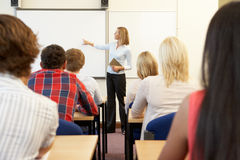 Students and tutor in class Stock Photography