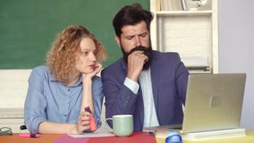 Students and tutoring education concept. Portrait of couple university students indoors. Exam in college. Young male. Teacher with female student over green stock footage