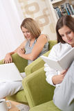Students - Two female students in living room Stock Photography