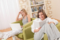 Students - Two female students studying in lounge Royalty Free Stock Image