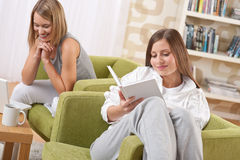 Students - Two female students studying in lounge Stock Photo
