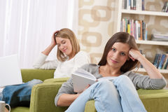 Students - Two female teenager in living room Royalty Free Stock Photography