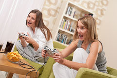 Students - Two female teenager playing TV game Stock Image