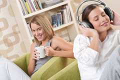 Students - Two female teenager relaxing in lounge Royalty Free Stock Photo