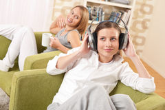 Students - Two female teenager relaxing in lounge Royalty Free Stock Image