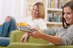 Students - Two female teenager watching television Royalty Free Stock Photos