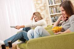 Students - Two female teenager watching television Royalty Free Stock Images