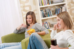 Students - Two female teenager watching television Royalty Free Stock Photography