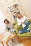 Students - Two teenage girls with laptop and book Royalty Free Stock Photos