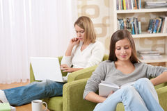 Students - Two teenage girls with laptop and book Stock Photo