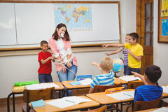 Students tying the teacher up. At the elementary school Stock Image