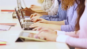 Students typing on computer with hands Stock Photo