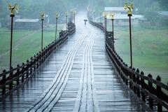 Students umbrella walks in the rain on the bridge to school. Stock Photography