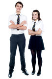 Students in uniform posing with arms crossed Royalty Free Stock Images