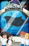 Students in uniform visiting aquarium Royalty Free Stock Images