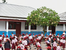 Students in uniforms morning exercises outside the school (Sumat Royalty Free Stock Image