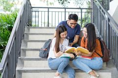 Students university asian together reading book study stock photos