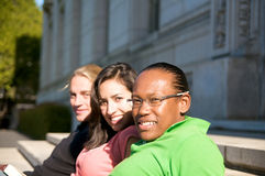 Students on University Campus. Diverse ethnic Students on university campus. A photo of African American, Hispanic and Caucasian students Stock Photos