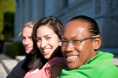 Students on University Campus. Diverse ethnic Students on university campus. A photo of African American, Hispanic and Caucasian students Royalty Free Stock Photography