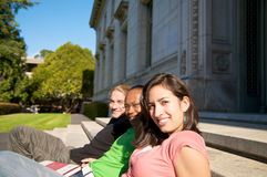 Students on University Campus. Diverse ethnic Students on university campus. A photo of African American, Hispanic and Caucasian students royalty free stock photo