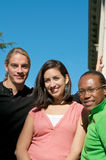 Students on University Campus. Diverse ethnic Students on university campus. A photo of African American, Hispanic and Caucasian students Stock Image