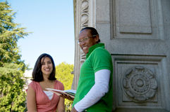 Students on University Campus. Diverse ethnic Students on university campus. A photo of African American and Hispanic students stock image