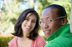 Students on University Campus. Diverse ethnic Students on university campus. A photo of African American and Hispanic students Royalty Free Stock Photos
